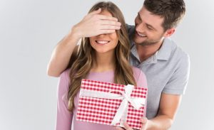 man-giving-a-gift-to-a-woman
